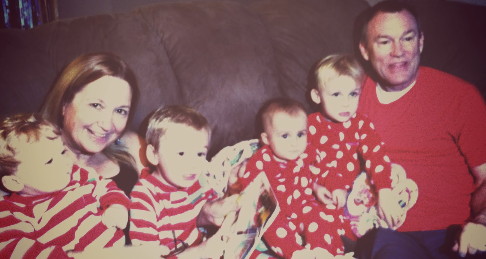 Grandparents with the grandkids(looks like 1962 cuz this filter offered the least blurry result-4 kids do not sit still at the same time)
