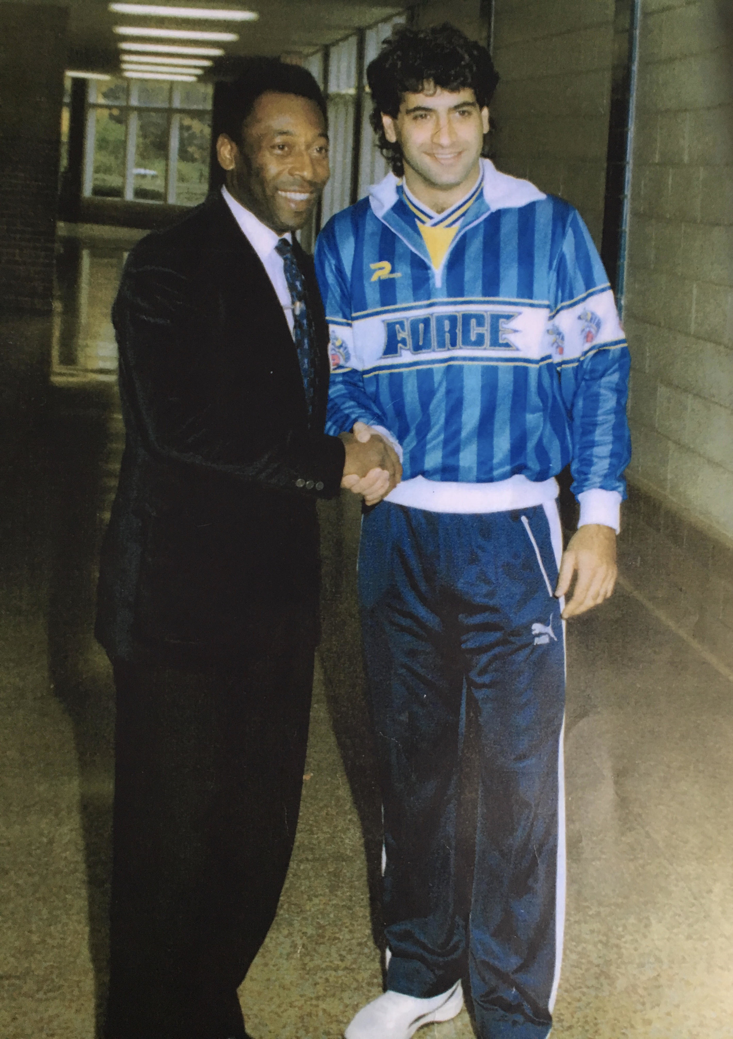 Ali and Brazilian legend Pele shake hands.