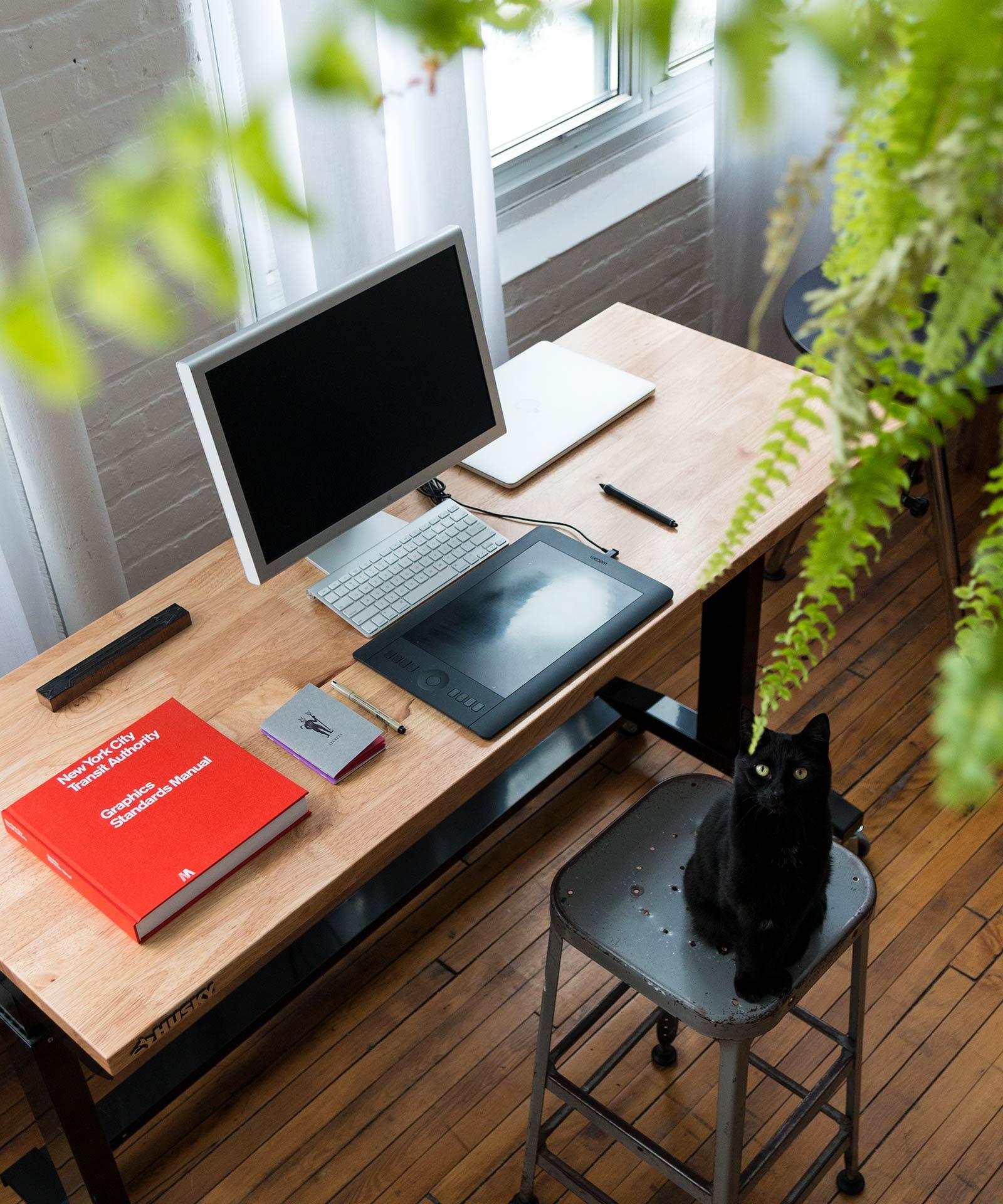 Graphic design workspace in loft studio