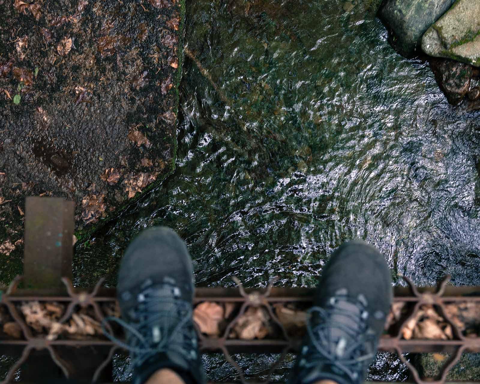 Standing on the edge of a steel bridge