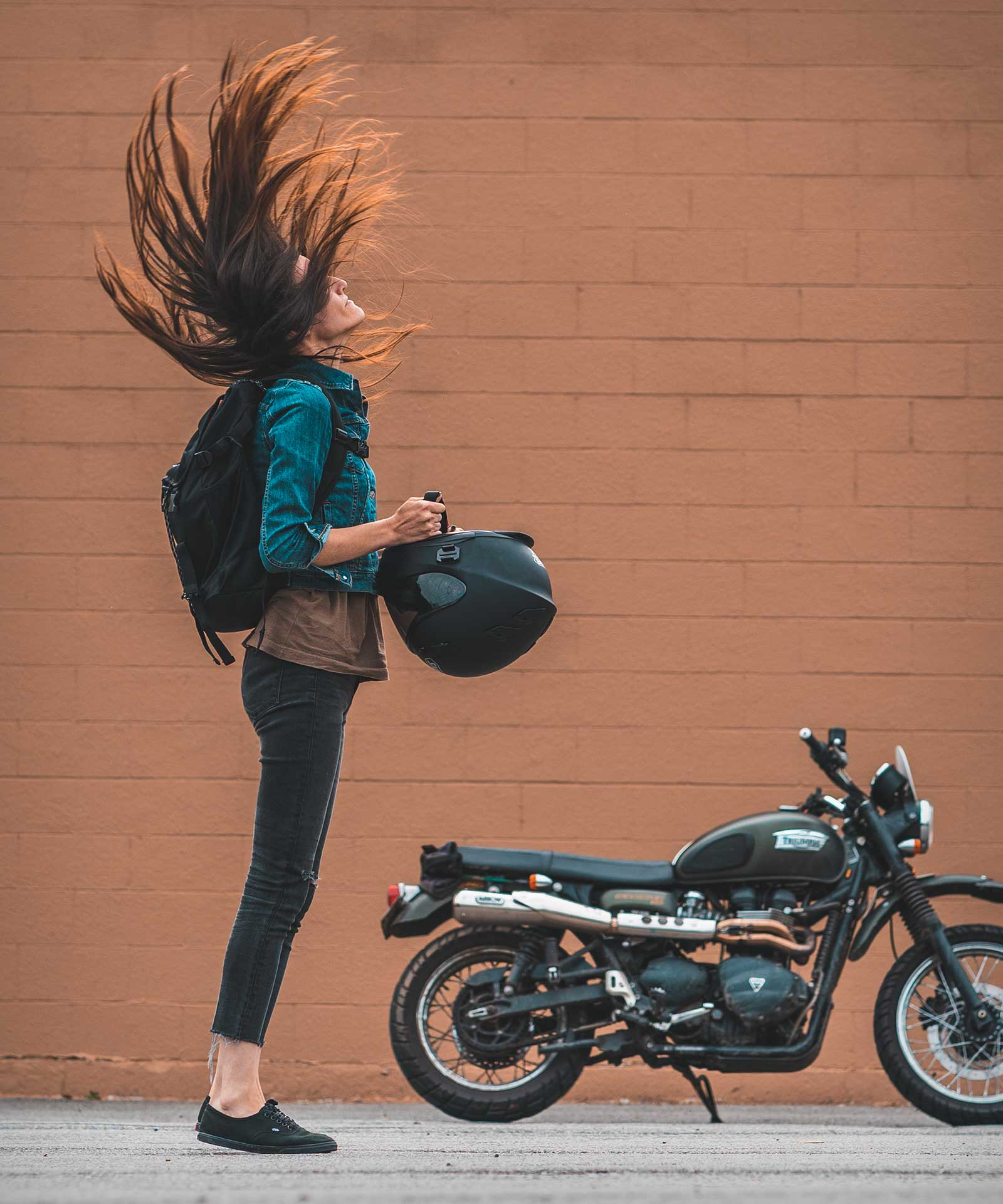 Helmet hair flip with Triumph Scrambler in background