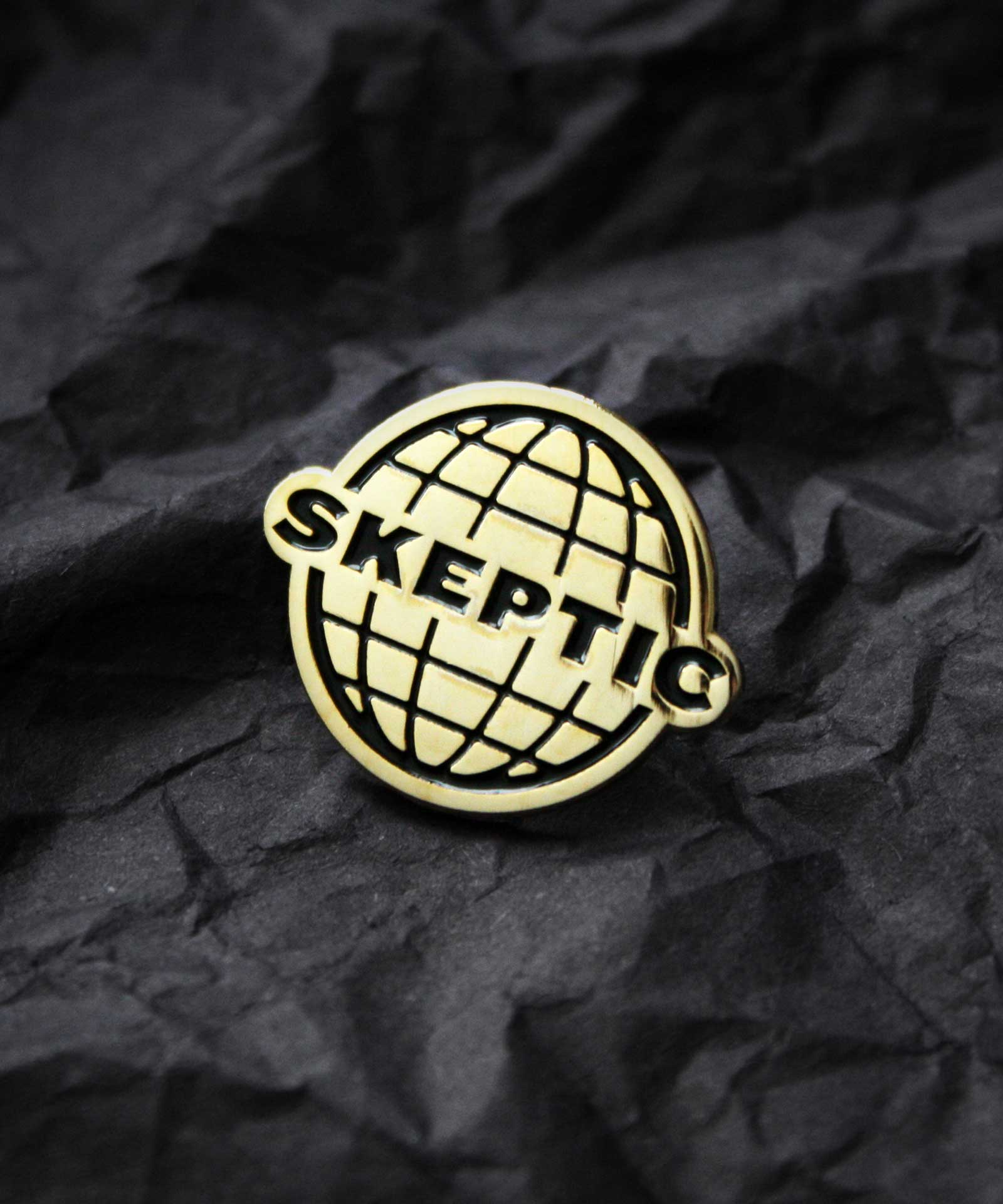 Product photography of gold enamel pin