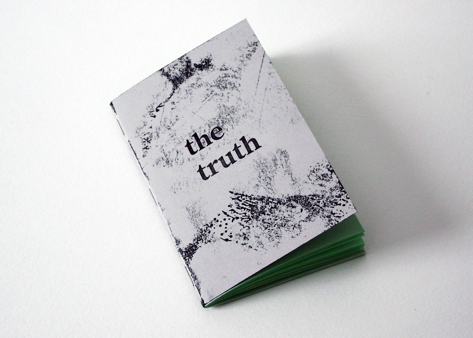 The Truth sketchbook with green pages