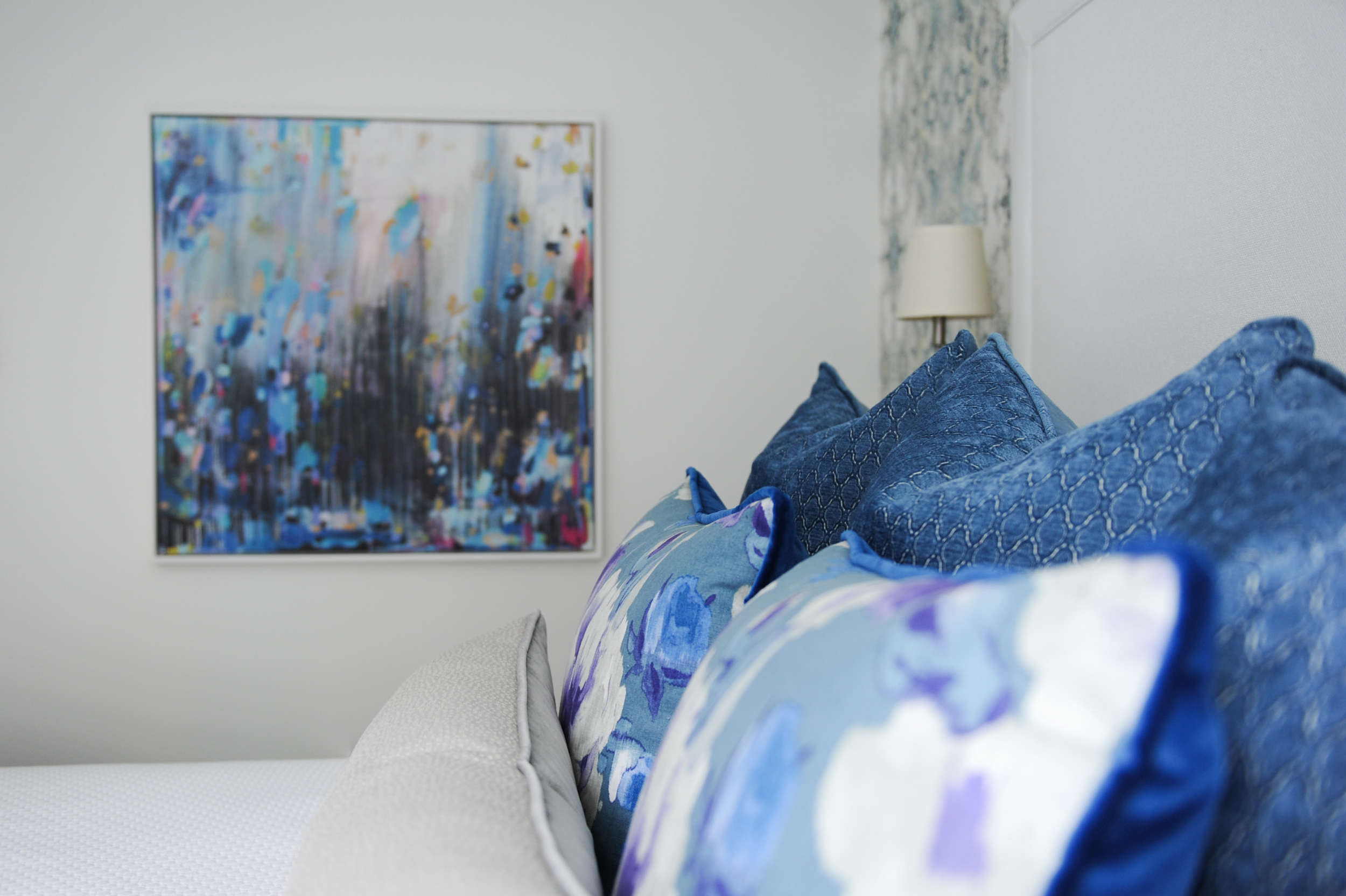 Some bold art and custom toss pillows to complete this beautiful bedroom.