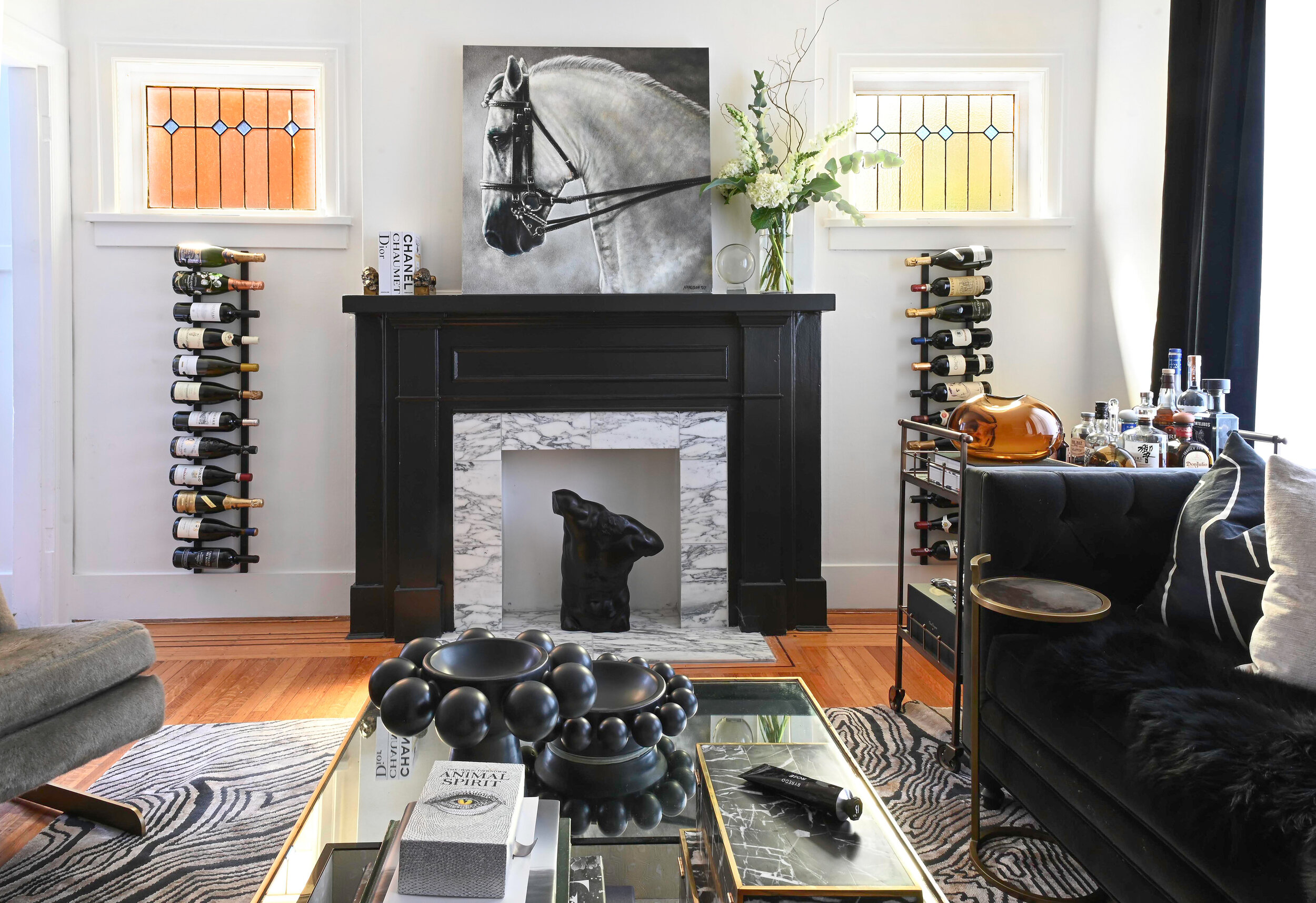 living room with marble fireplace by Chrissy Cottrell