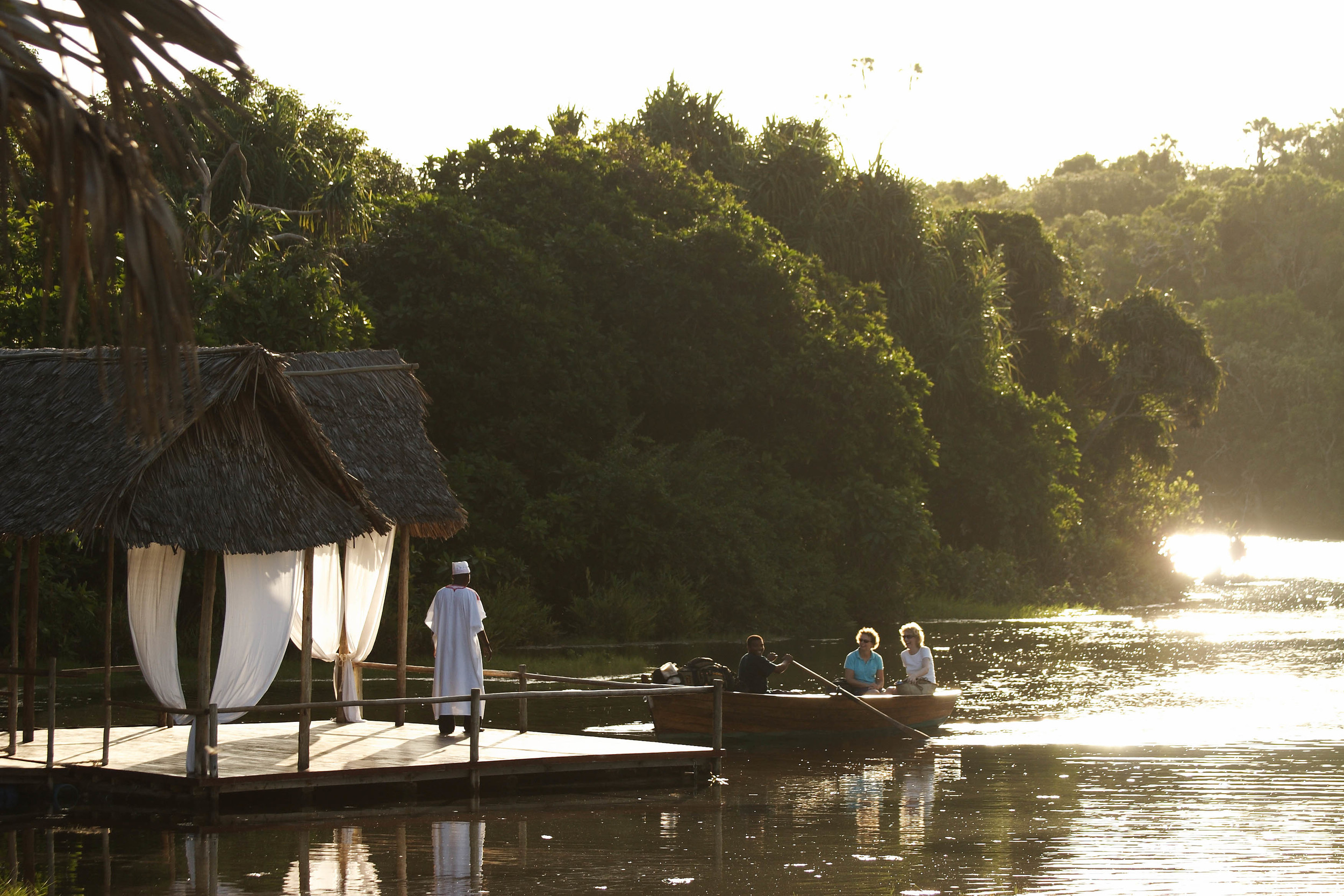 Arrive on our airstrip and rowed across the lagoon towards camp.jpg