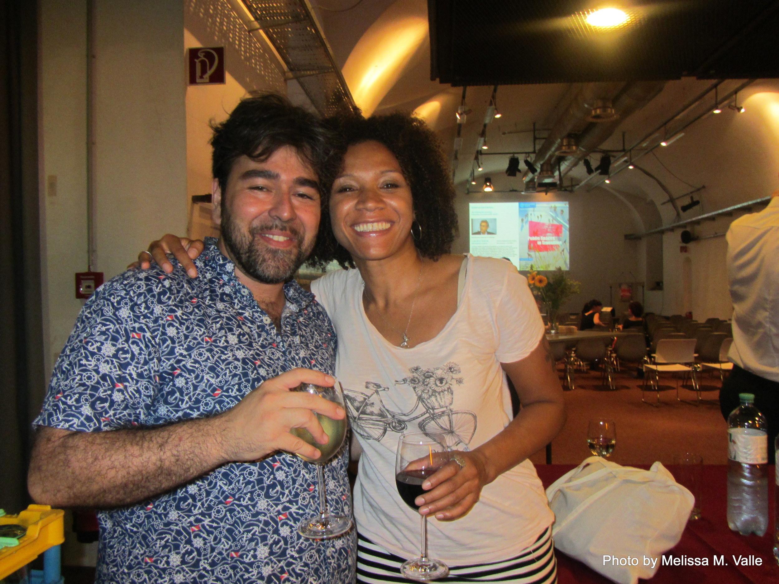 7.7.14 Vienna, Austria-wining it up in Museum Quartier after Amin lecture (5)- me and Estuardo.JPG