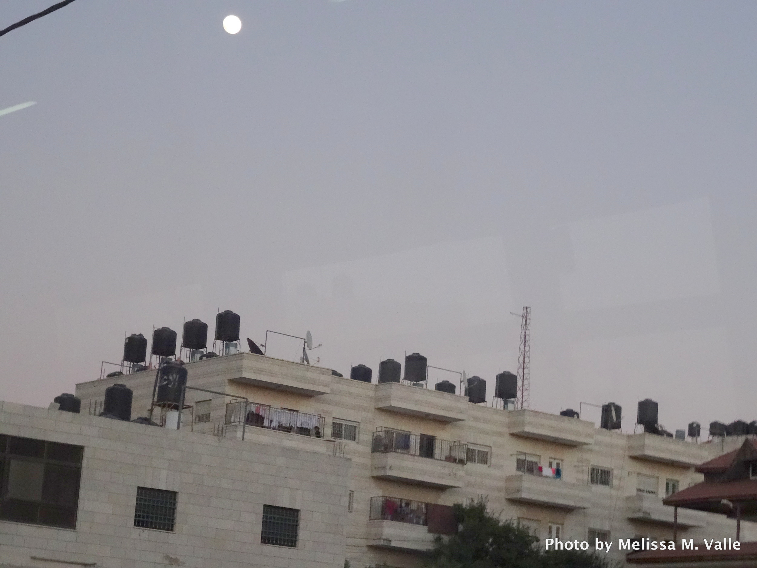 Water cisterns atop roofs in Palestine