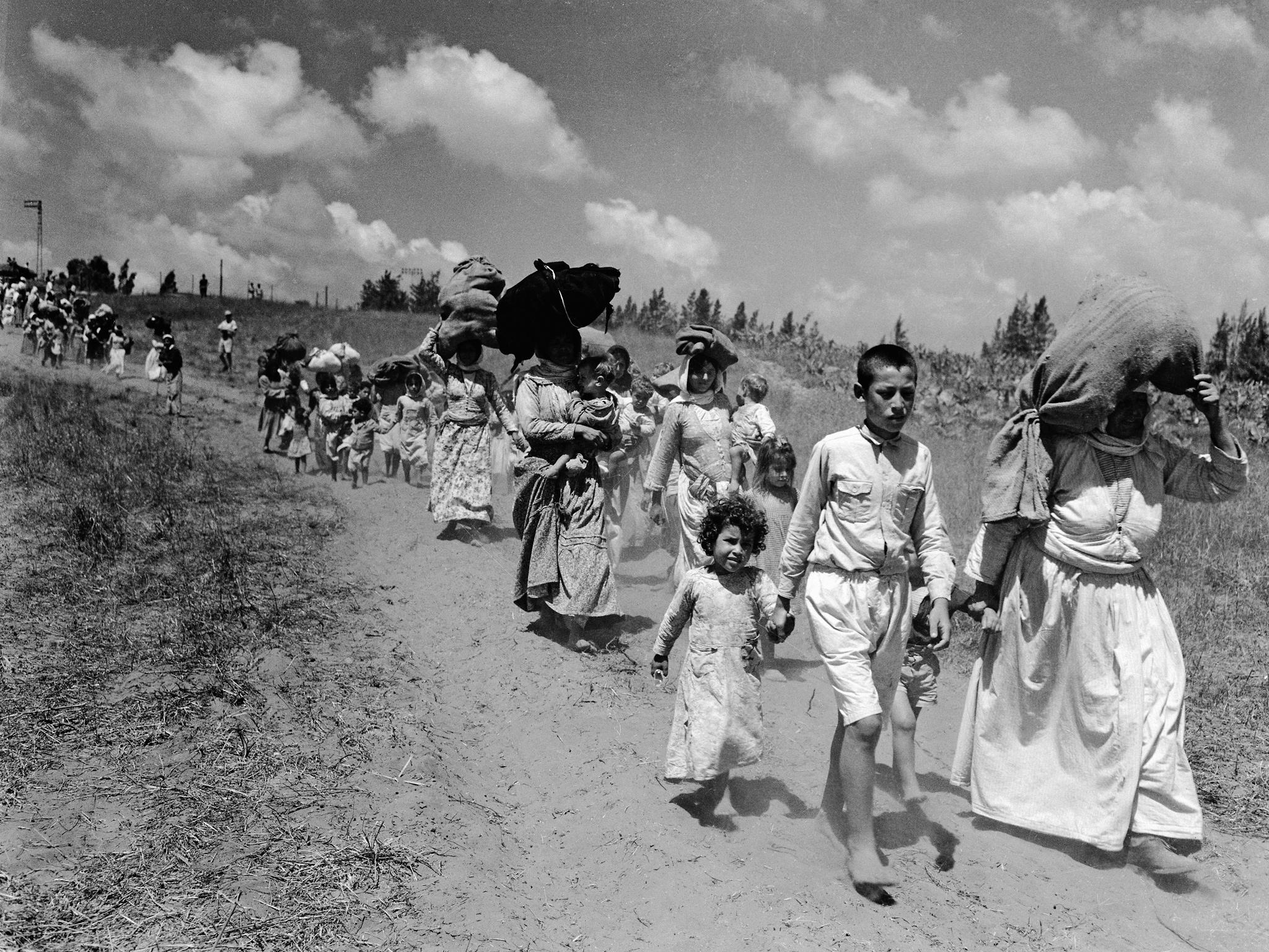 Palestinian refugees leaving a village near Haifa, June 1948. Photo by Corbis.