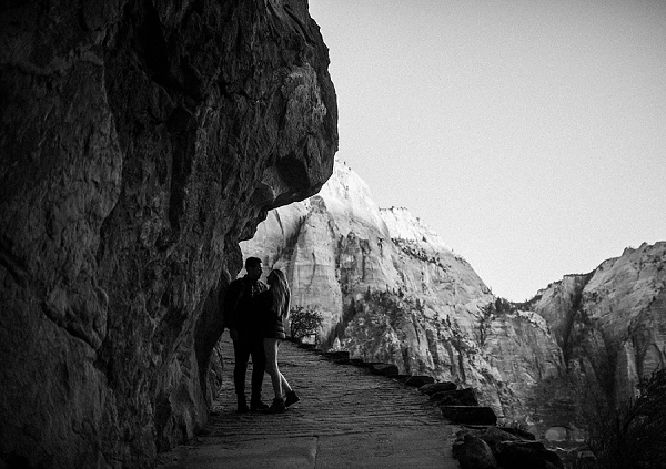 Hiking in Zion National Park for their desert engagement session.