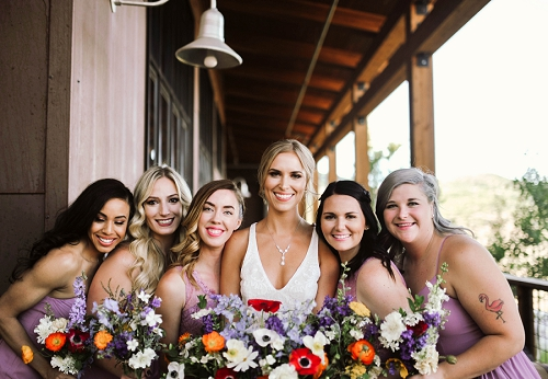 Bride and her bridesmaids in park city utah at high west distillery