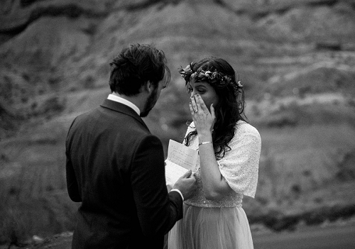 Bride cries during vow ceremony in Utah desert