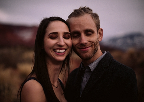 Couple smiling at their engagement shoot in Castle Valley, Utah