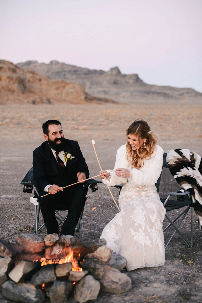 Couple makes s'mores at their desert elopement