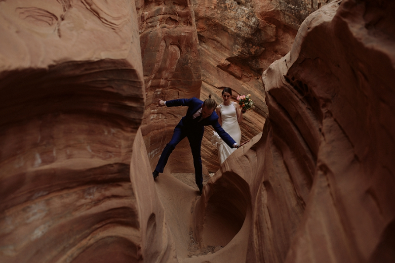 Couple walks through slot canyon together near Moab Utah