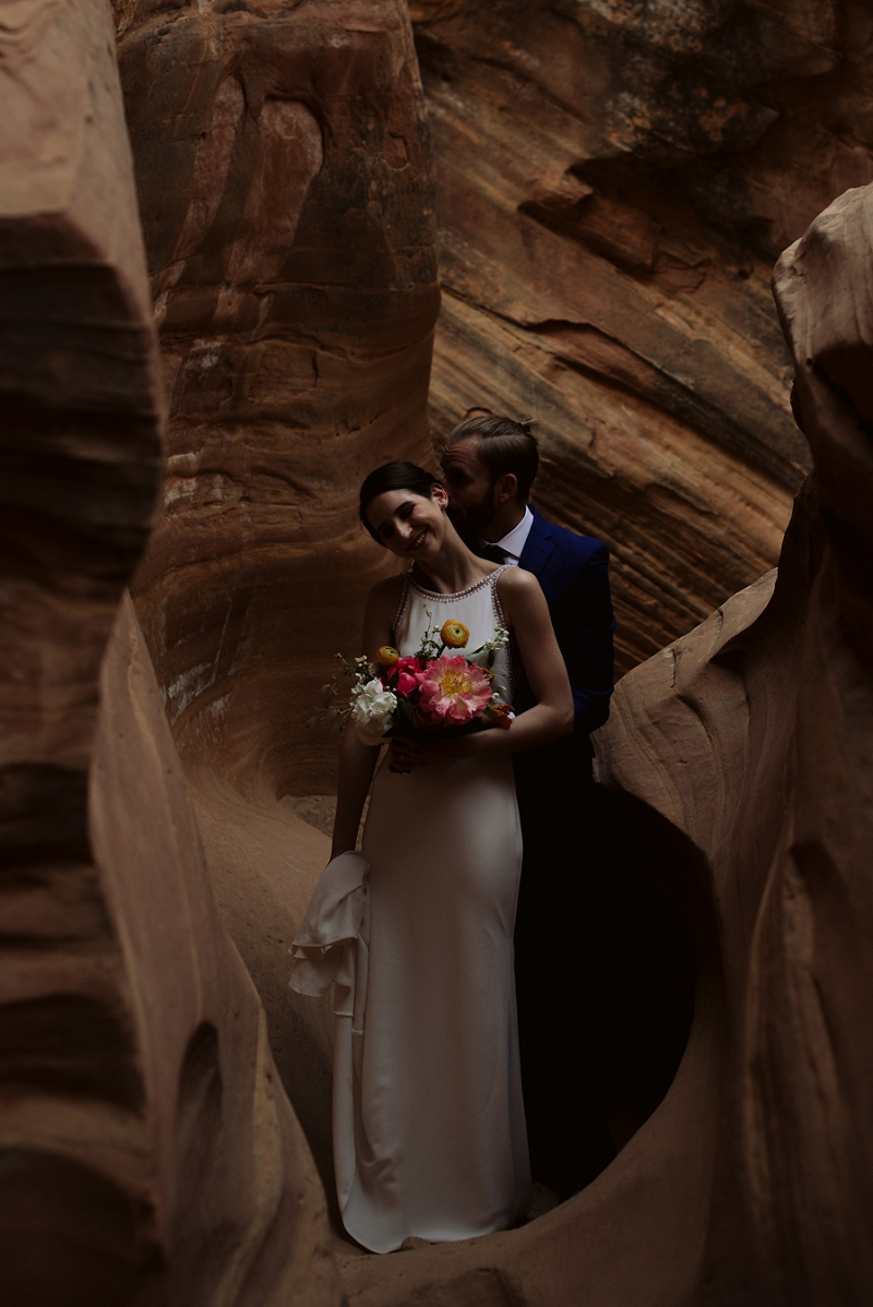 Couple walks through slot canyon for their elopement