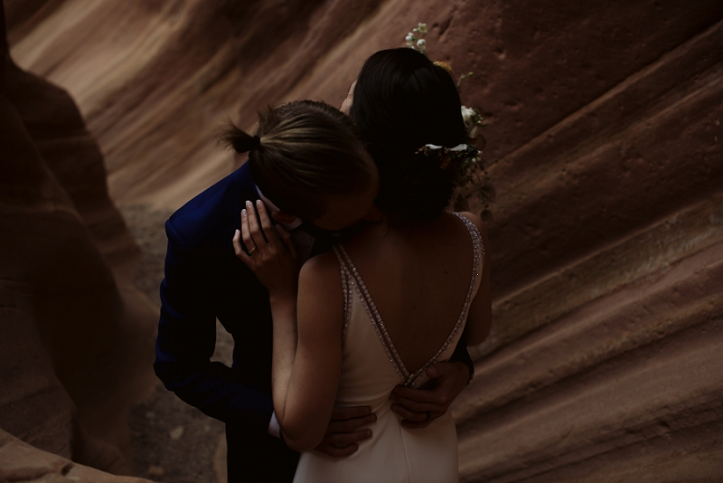 Couple embraces in canyon near Moab Utah