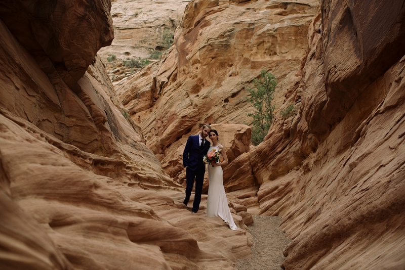 Couple stands in the southwest's red rock desert near Moab Utah
