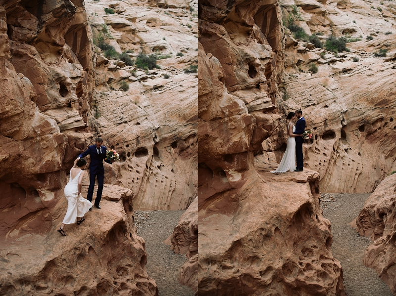 Couple climbs up rocks near Moab Utah