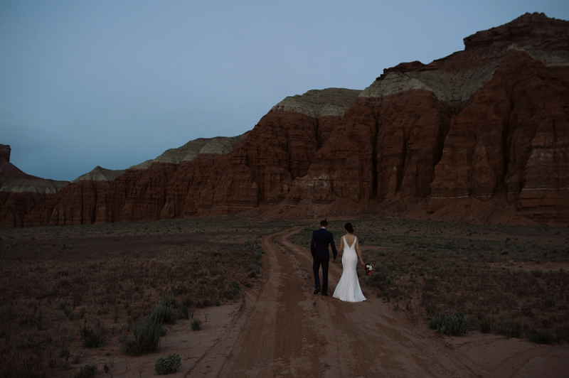 Couple walks through Goblin Valley Utah