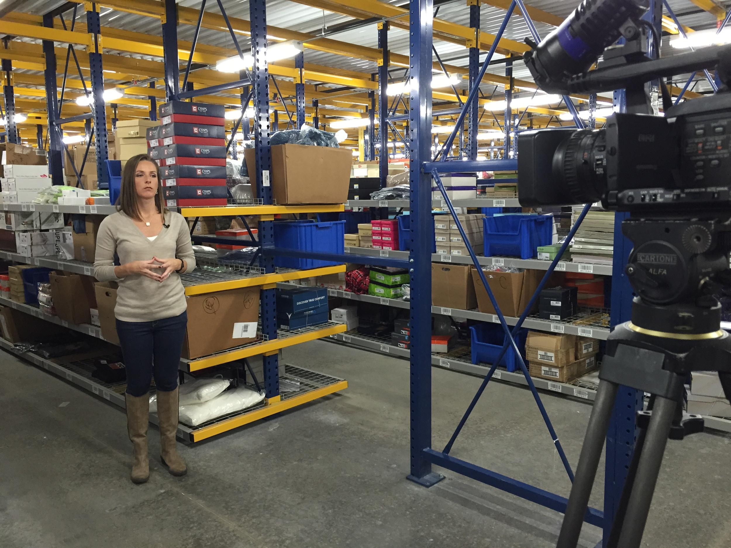 Time Warner Cable News reporter, Kate Gaier, on site at Belk's distribution center.