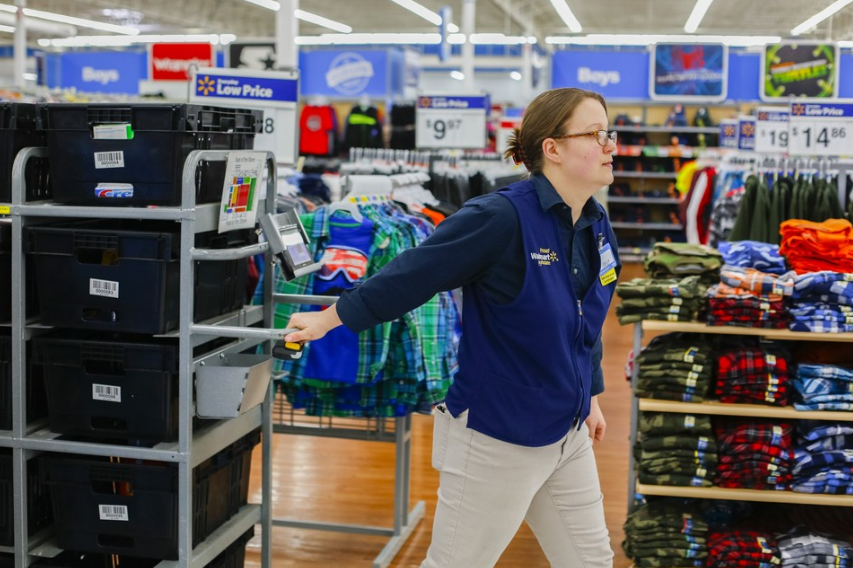 Wal-Mart has put some of its cavernous stores to use as mini-distribution centers for online orders. Supervisor Emily Merritt gathers items that have been ordered online for shipping at a Wal-Mart in Springfield, Mo. Ms. Merritt and her team pick about 1,000 items a day from the one store.   WESLEY HITT FOR THE WALL STREET JOURNAL