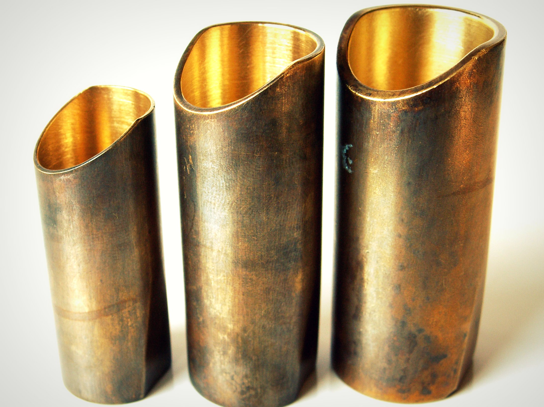 Brass will also oxidize. Inside this cylinder you see clean raw brass. On the outside you see the effects of age. Gorgeous!