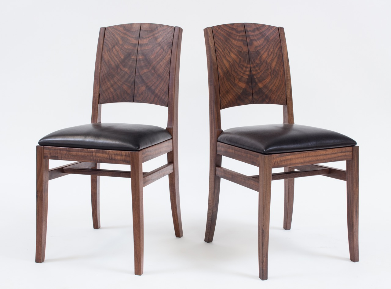 Robin Wilson's pair of chairs in Claro walnut, with spectacular bookmatched back supports.