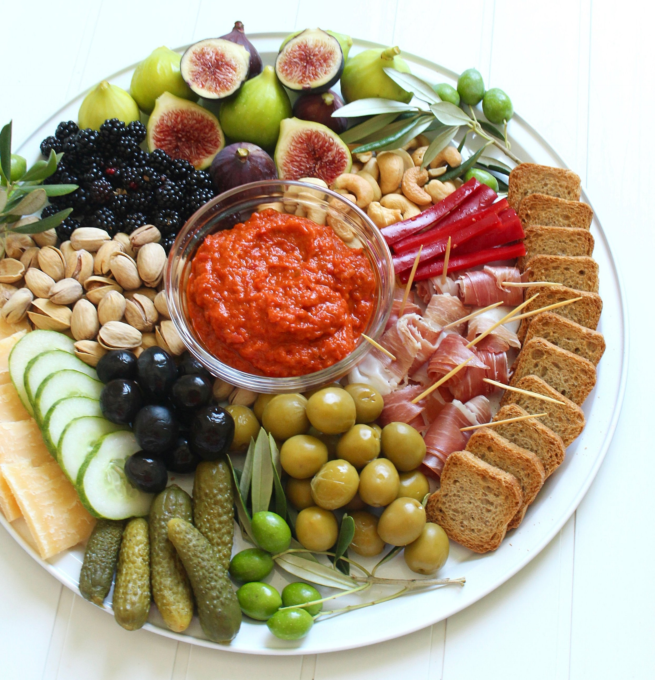 Lunch time platter Croatian styles! Roadside figs and blackberries, green and black olives, pungent cheese, rolled prosciutto, gherkins, fresh veggies, biscotti, nuts and ajvar - a super popular pepper-based condiment here.