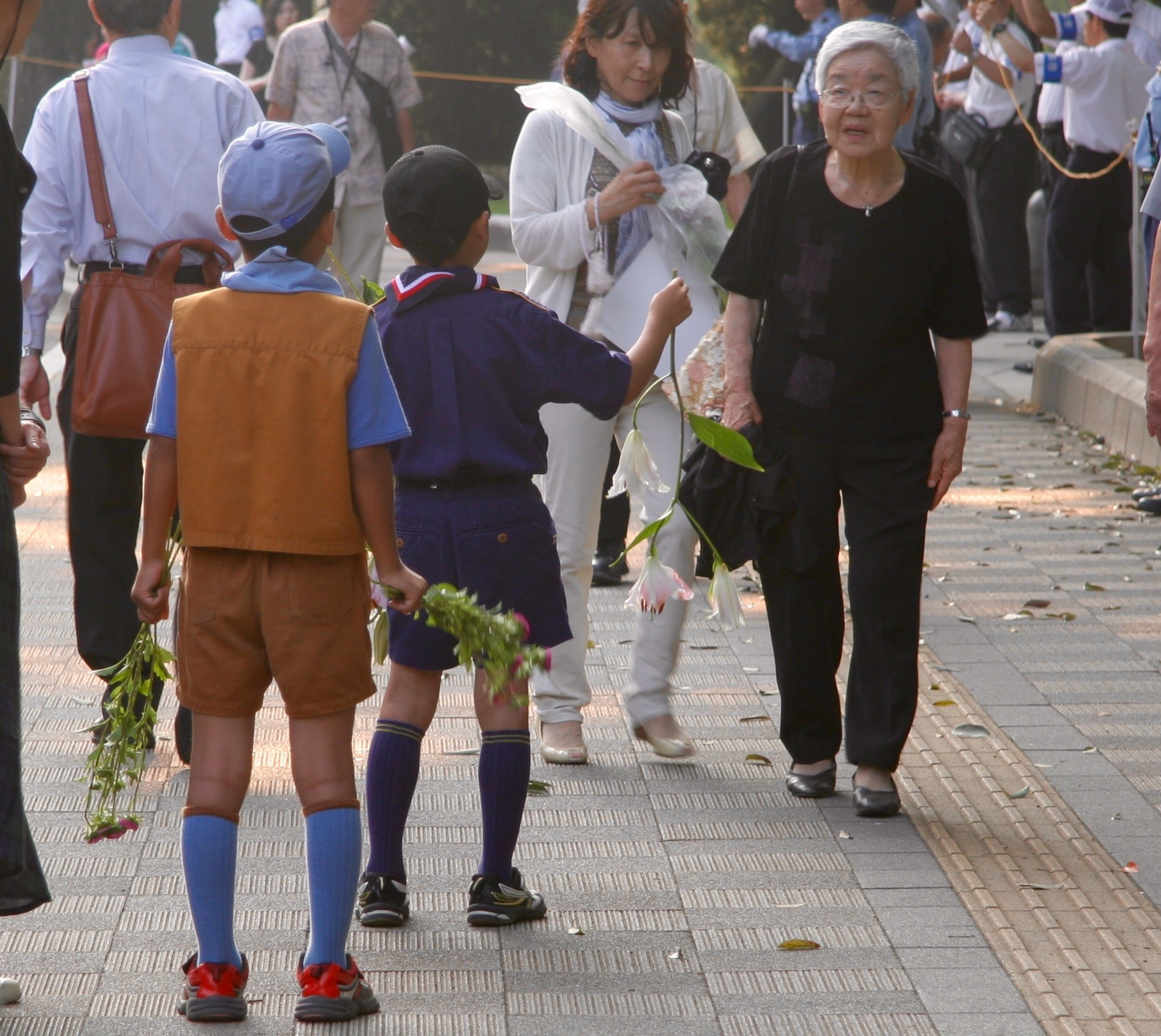 Young schoolchildren handed out flowers for people to lay at the cenotaph