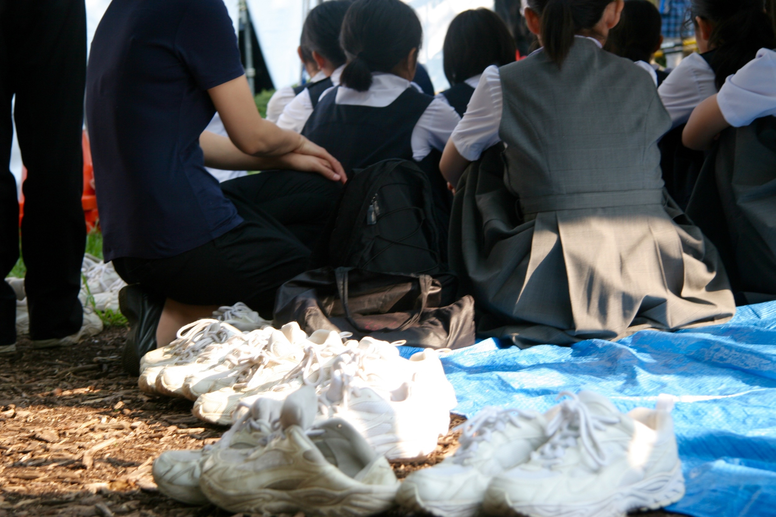 Students sat on tarps around the ceremony grounds to listen to speeches from the mayor, prime minister Abe Shinzo, and other schoolchildren