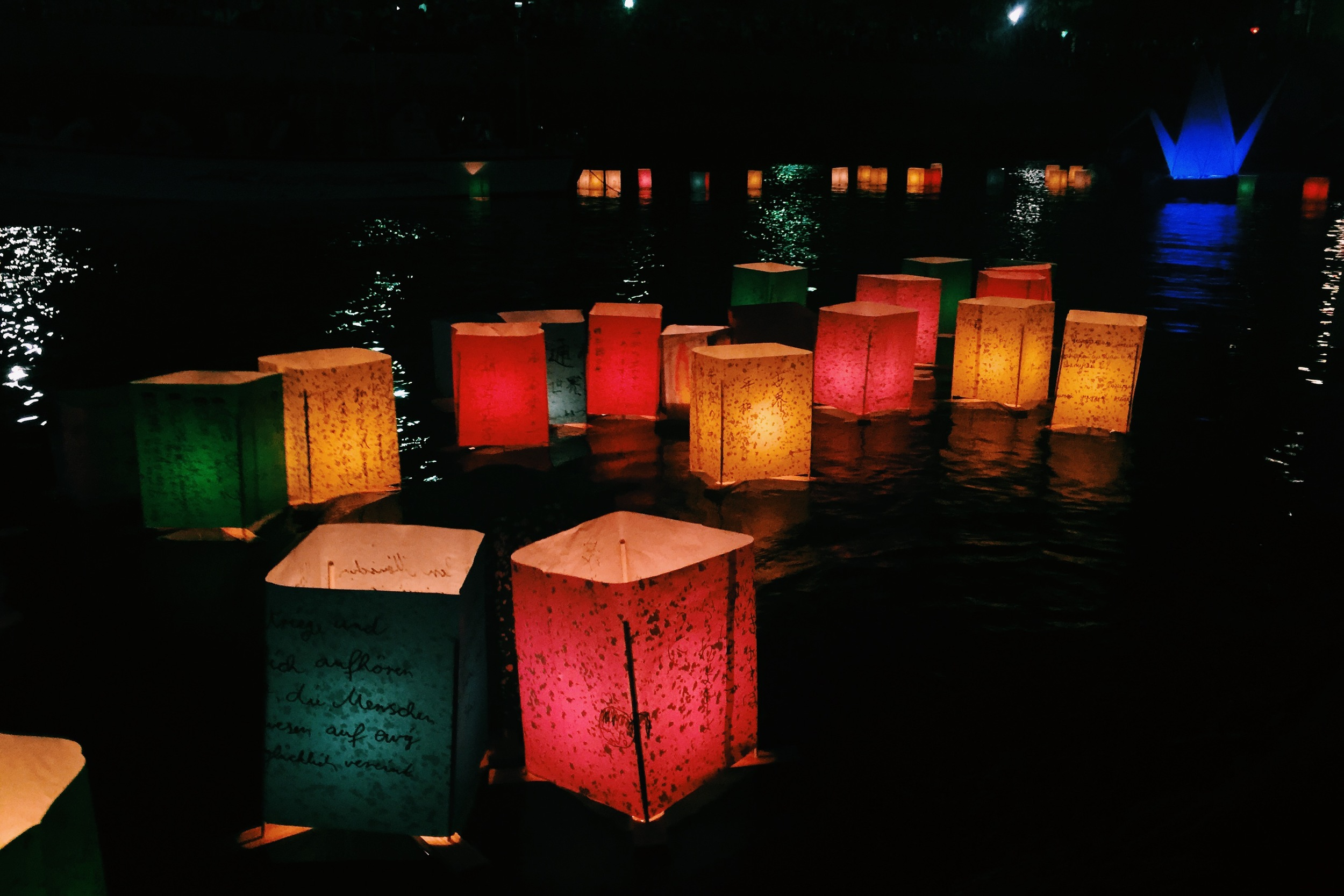 The sun sets, the cicadas quiet, and the lanterns come out