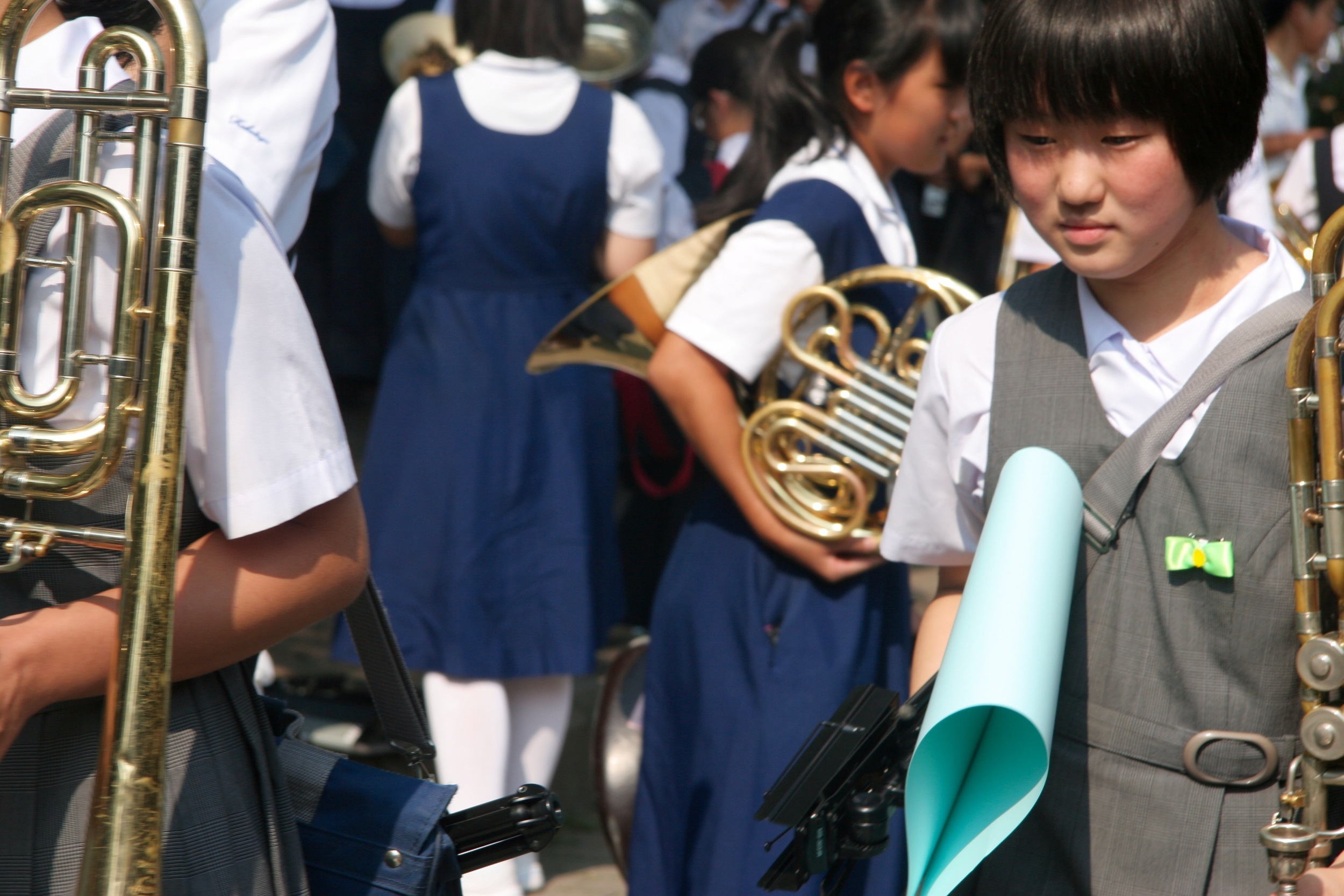 Students pack up their instruments as the ceremony ends, while others went to read the story of Sadako Sasaki in multiple languages in the park