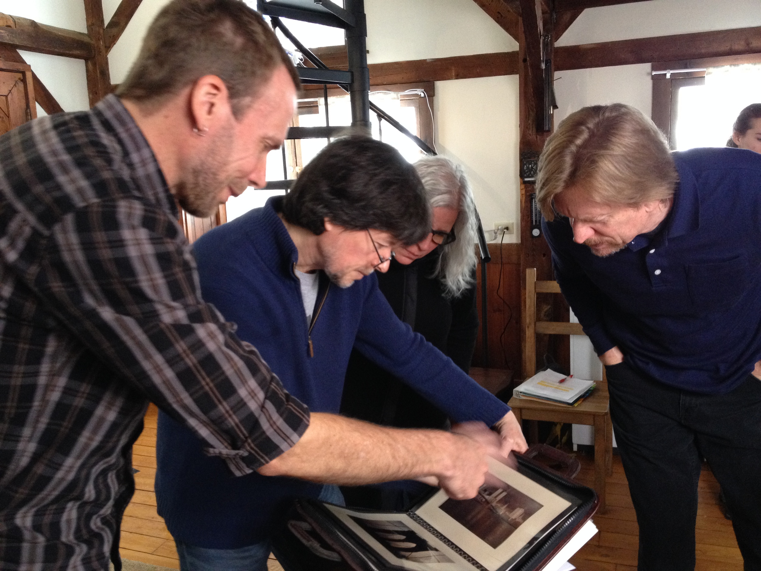 Selecting archival photos with Ken Burns in Walpole, MA, while filming for Essential Lens.