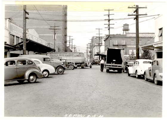 SE Alder St between 3rd and Union Avenues in 1940. The building on the left would later become Corno's Market (City of Portland Archives)