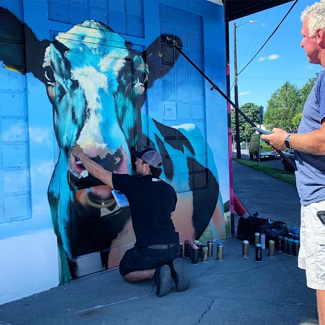 The perfect doorway to the Sunshine Dairy project! ✨🐄✨Thank you so much for painting and being down with being on the news! @define_arts Love the wild colors of this piece. Check out @kgwnews tonight at 11pm for the latest story on this epic project! #definearts #sunshinedairy #pdxart #portlandmurals #pdxmurals #pdxstreetart #portlandstreetart #psaa #portlandstreetartalliance #communityartproject