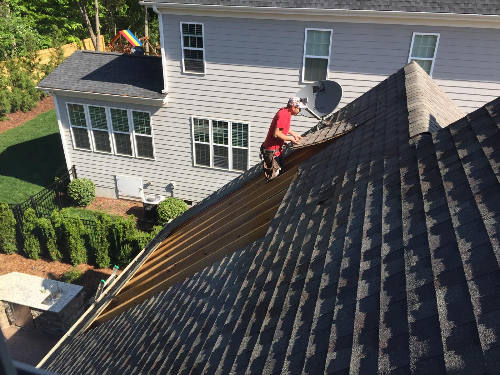 Opening the roof. Demo of existing roof shingles and sheathing.