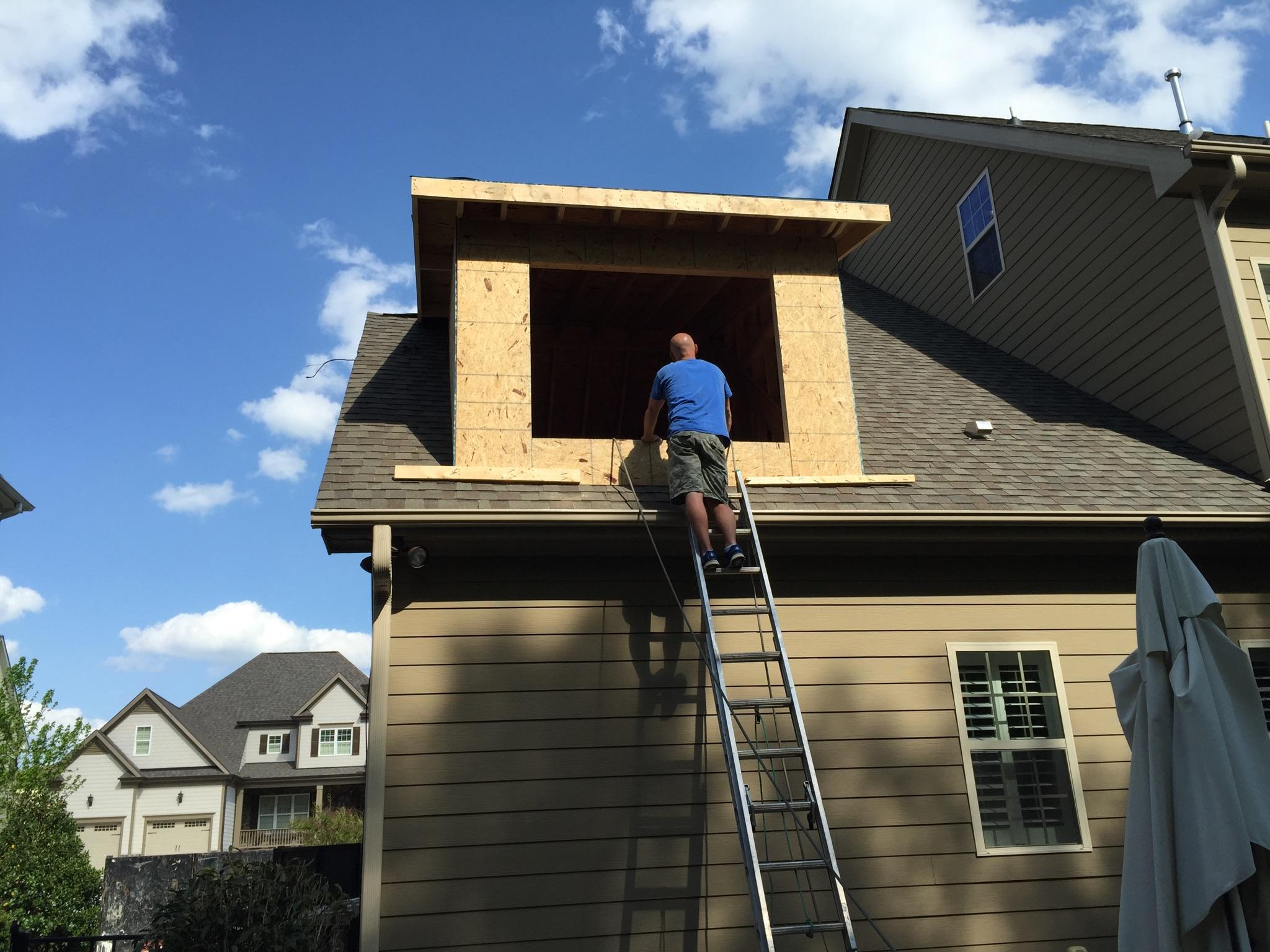 A simple shed dormer opens the attic space.