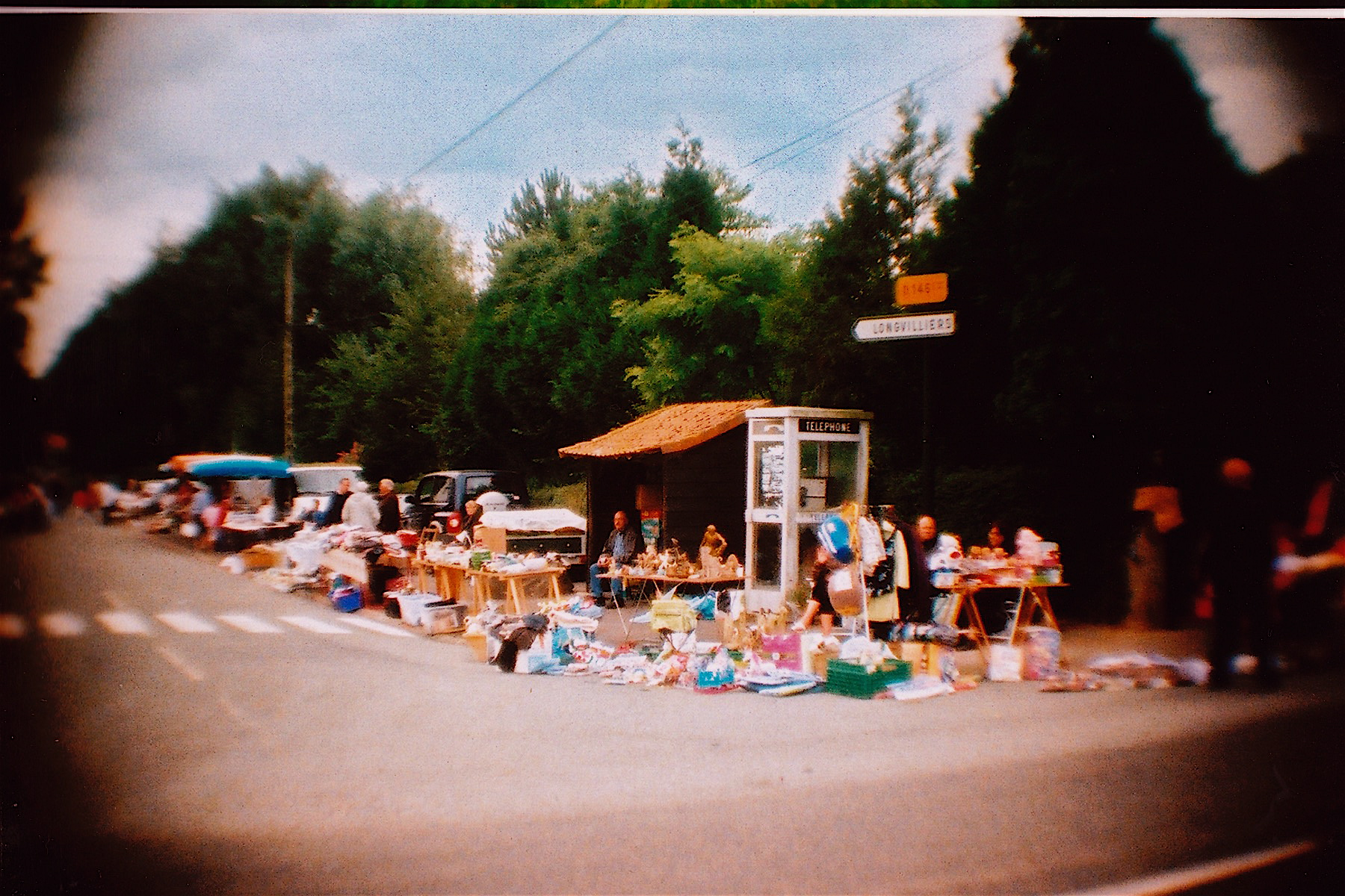 A brocante (flea market) where they found things they might need. At this one they bought a harmonica and a wooden-handled corkscrew.
