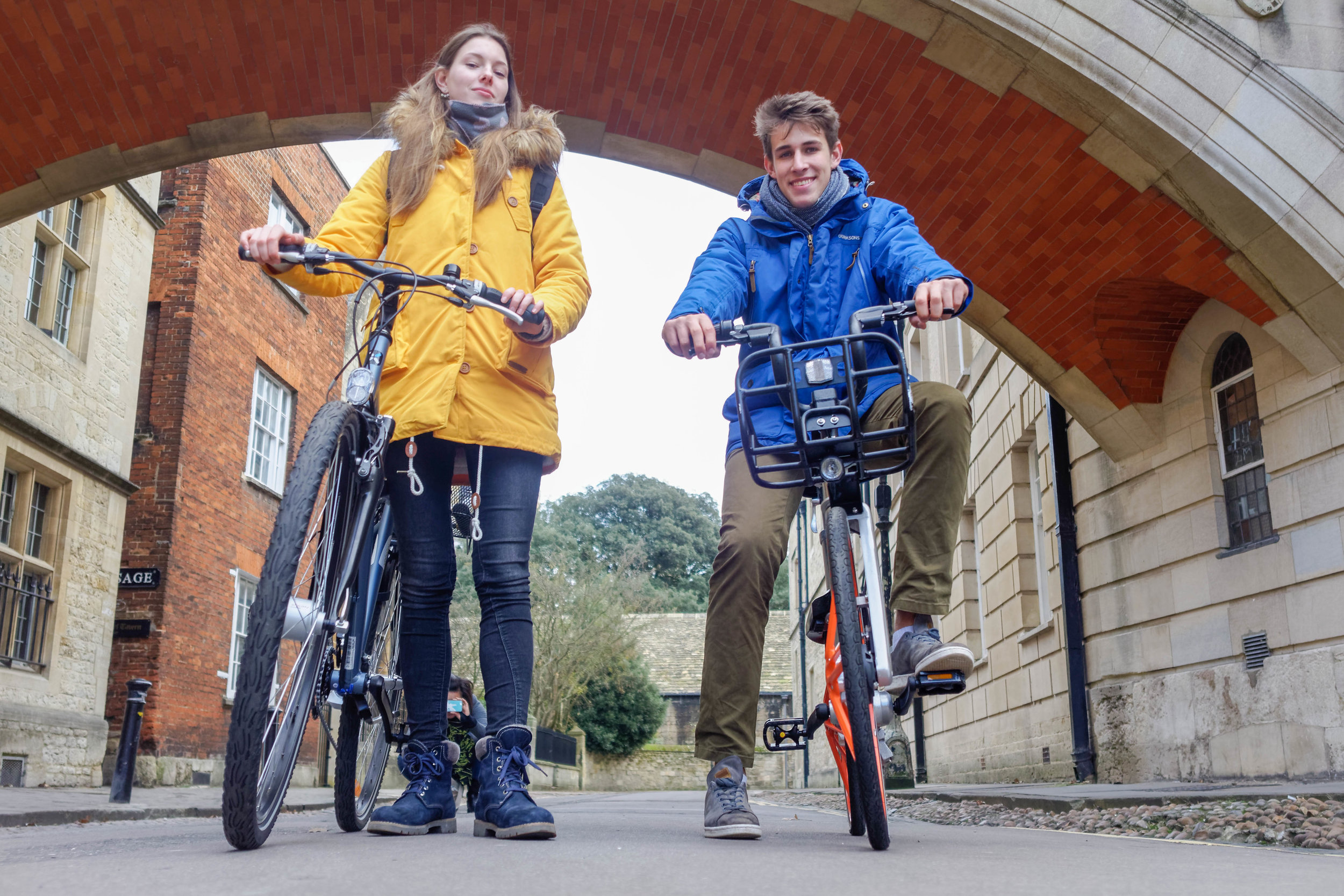 Cycle.land interns Anja and Max, featuring one of our community bikes and a mobike.
