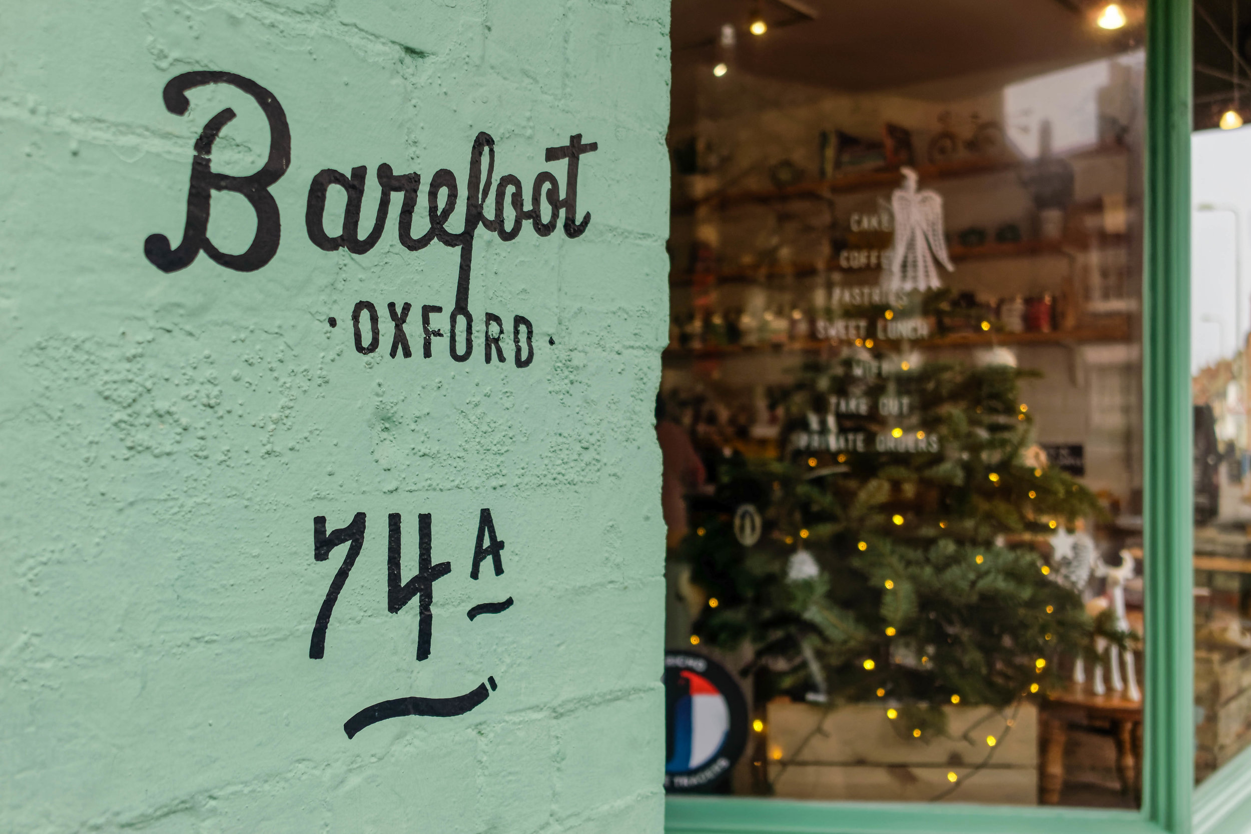 Barefoot's unmistakable seafoam green front features a small Christmas tree beside the usual selection of cakes and breads.