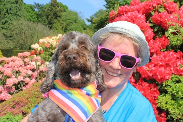 Michelle Savage of the Sing with Pride Choir with dog Frank enjoying the Stody Big Gay Out in May 2018