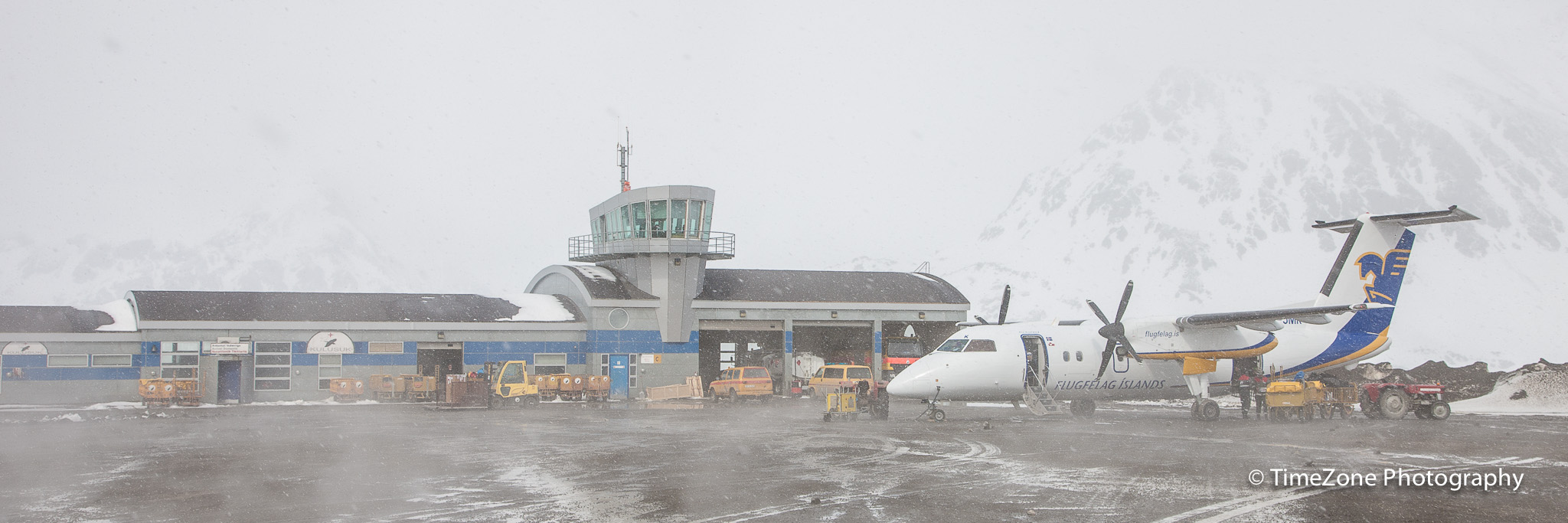 Air Iceland Dash-8 200 in front of the terminal in Kulusuk on a foggy and snowy winter day in May 2012.