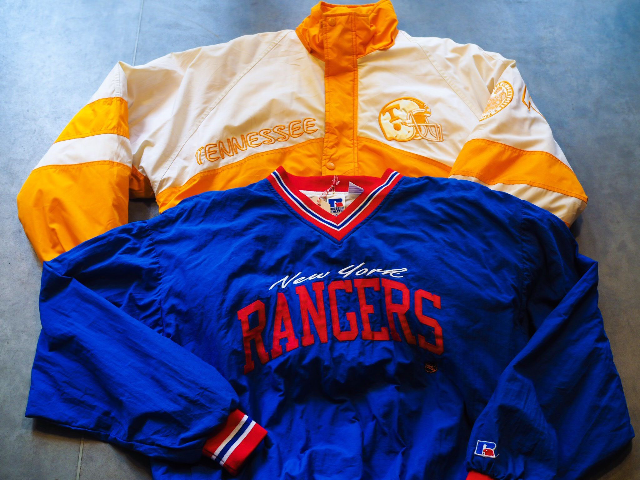 This 1990s New York Rangers Jersey/Sweater by Russel Athletic merges the outerwear feel of a jacket with the easy going nature of a sweater, and check out those colours!