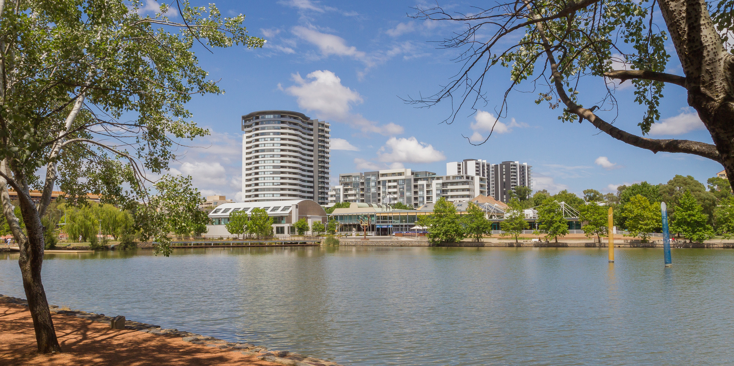 """Lake Ginninderra and the """"The Altitude"""" Apartments."""