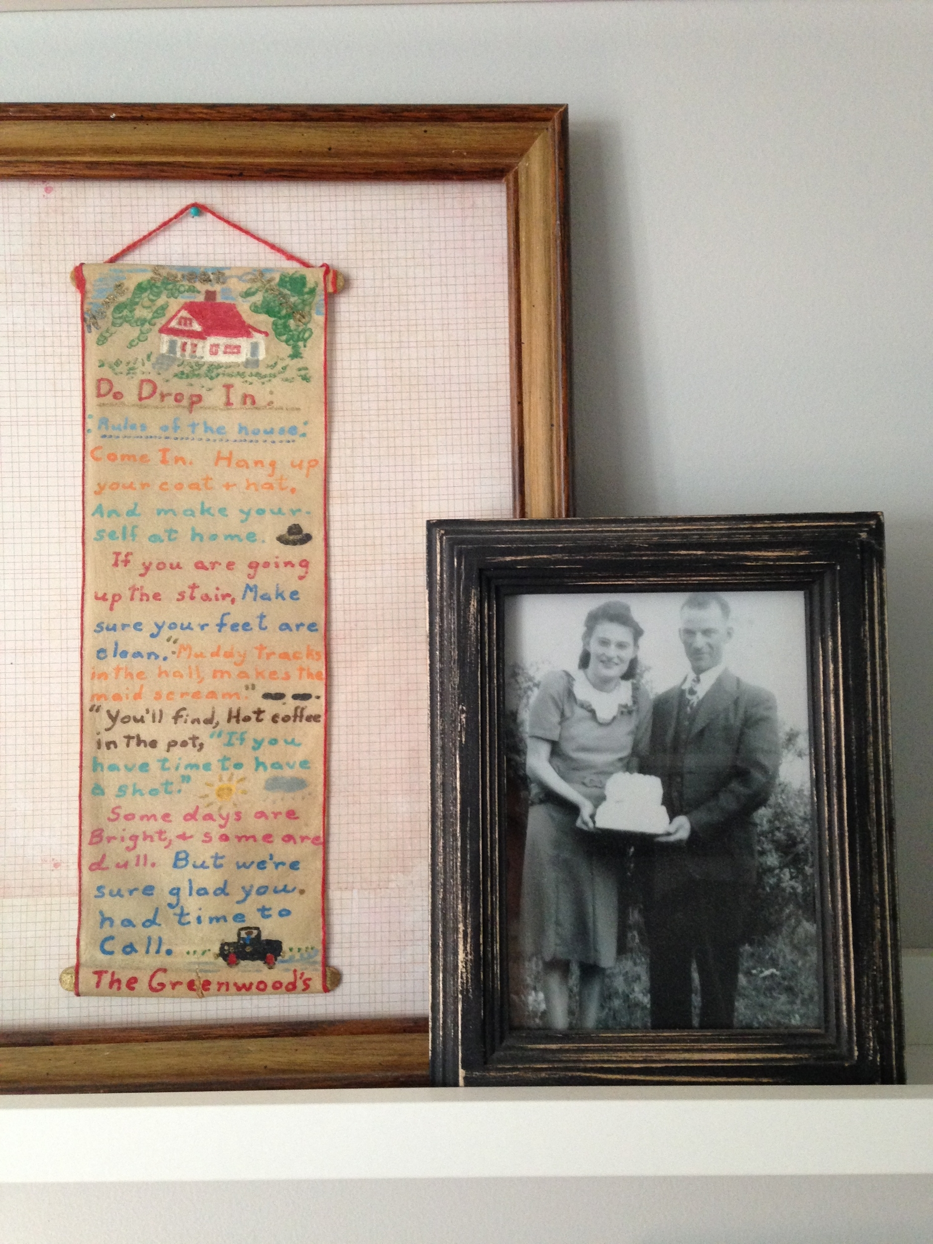 This 'rules of the house' hung in my gramma's farmhouse and now in mine. She made it using some old paper, popsicle sticks and some paint. Crafter after my own heart. <3