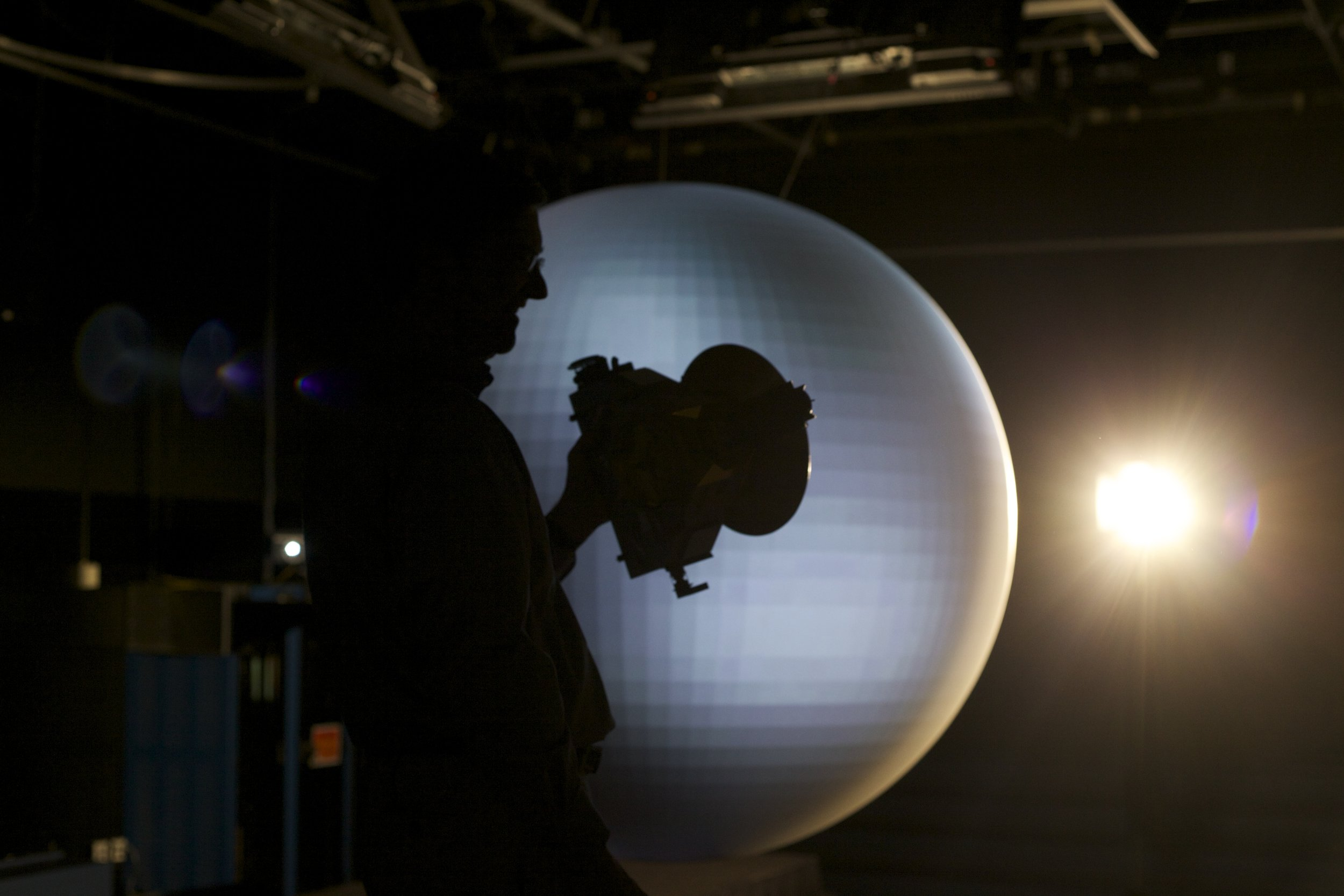 Hal Weaver, silhouetted on set with New Horizons, Goddard Space Flight Center, Greenbelt MD, July 2015