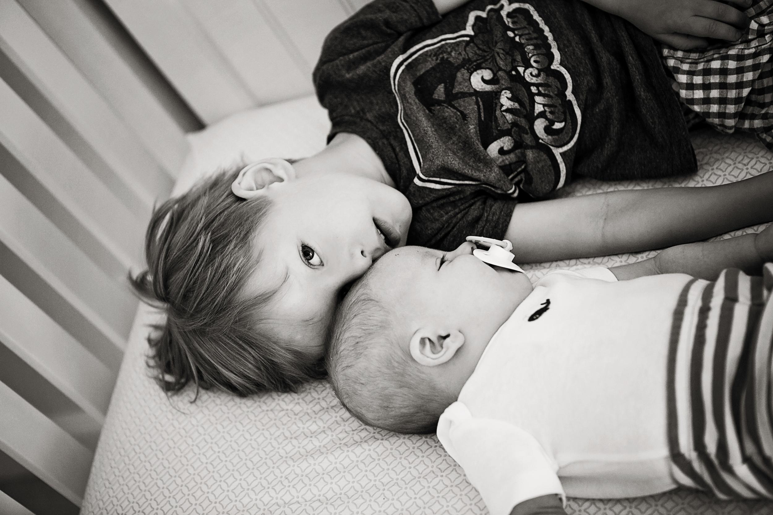 Garrison & Ford snuggling in the crib-8b&w.jpg