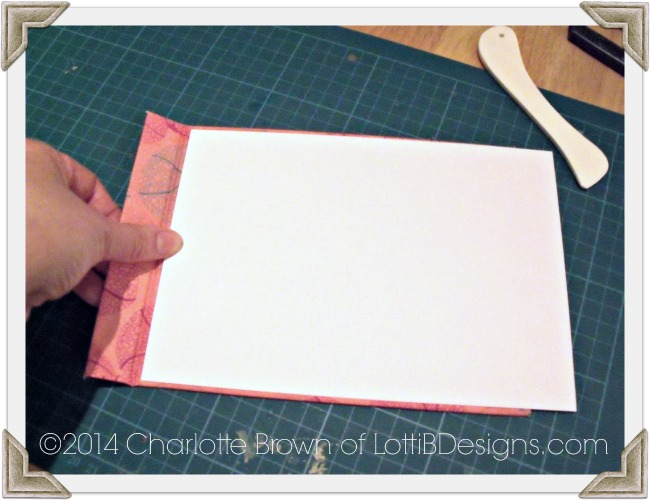 Measure then front cover insert carefully so that the hinge is clear, then trim the card to size