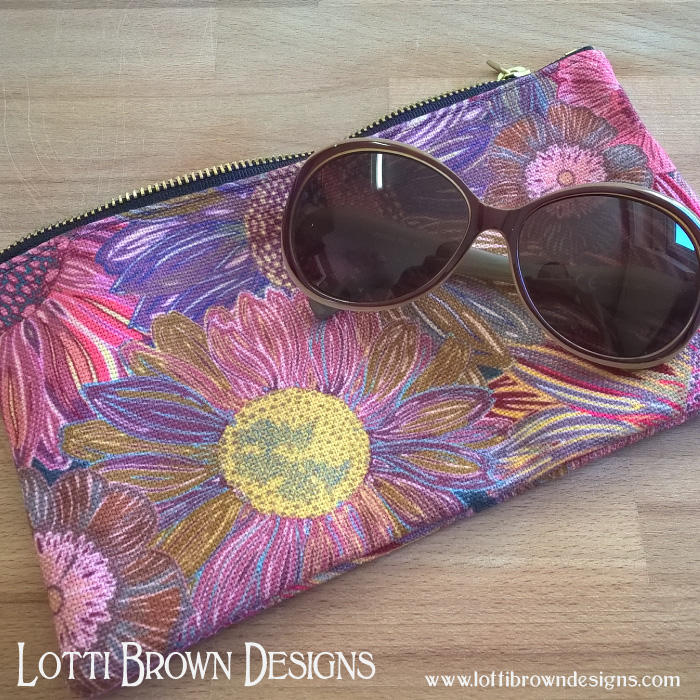 Lotti Brown, pink daisy pouch, at society6